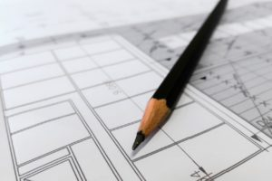 architectural glass finishes included in architect schematic with pencil and paper